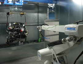 Detail of the automatic treatment with robot in a water curtain booth