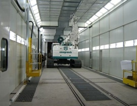 Four-stage pressurized painting-drying booth (16 + 8 + 8 + 16 meters) for a total length of 48 meters. Top opening over its entire length for inserting pieces with overhead crane