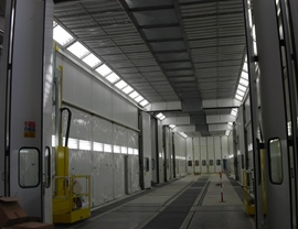 Four-stage pressurized painting-drying booth (10 + 10 + 10 + 10 meters) for a total length of 40 meters. Front and side openings and mobile platforms for operators