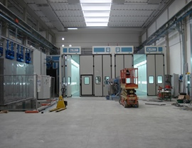 Pressurized painting-drying booths for large pieces with upper opening for inserting pieces with overhead crane