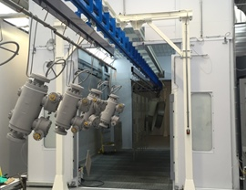 Internal view of pressurized spray booth with vertical air ventilation and with totally grid floor