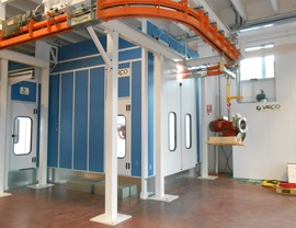 Pressurized spray booth on metal basement with automatic sliding doors